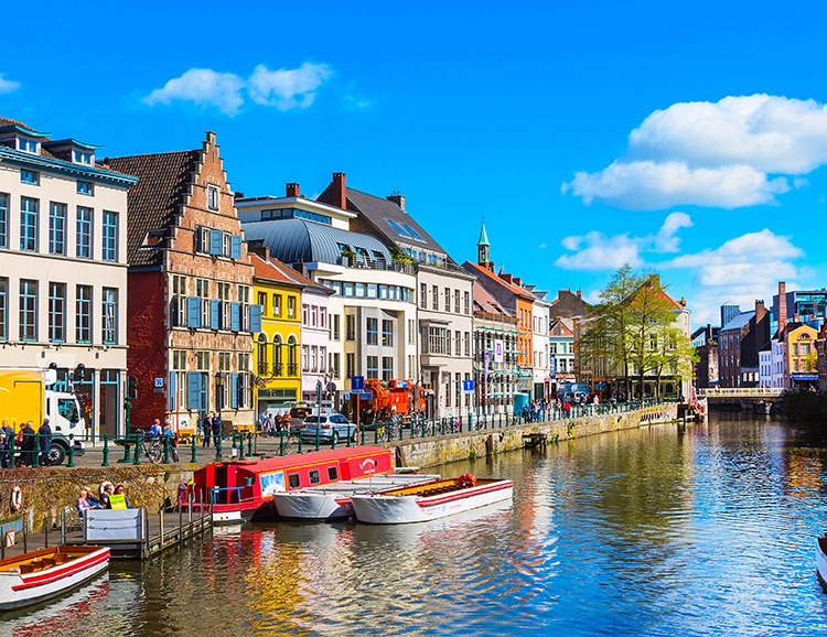 Old colorful traditional houses along canal in Ghent, Belgium