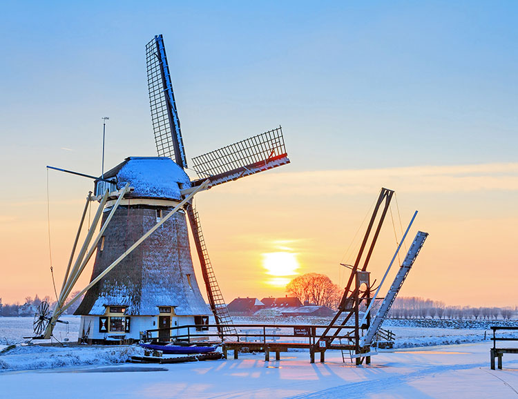 Beautiful sunset behind an old mill in winter in the Netherlands